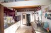 die Küche mit angrenzendem Hauswirtschaftsraum